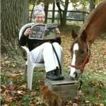 Kassie-reading paper-sq